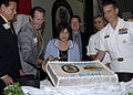 US Navy 091022-N-8283S-062 Capt. Mark Cedrun, commanding officer of the amphibious assault ship USS Boxer (LHD 4) and guests cut a cake in the ship's hangar bay.jpg