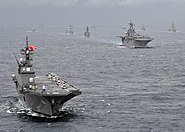 US Navy 091117-N-6233H-098 The Japan Maritime Self-Defense Force helicopter destroyer JS Hyuga (DDH 181) leads a formation of U.S. Navy and Japan Maritime Self-Defense Force sips during Annual Exercise (ANNUALEX 21G)