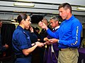 US Navy 100307-N-1240O-026 Cryptologic Technician (Maintenance) 1st Class Annette Torres receives communion from Cmdr. Putnam H. Browne.jpg