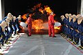 US Navy 100604-N-0569T-113 Midshipmen work together to fight a fire at the Fire Fighting Trainer at Naval Station San Diego.jpg