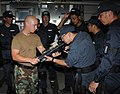 US Navy 100705-N-7058E-054 Hull Maintenance Technician 1st Class Keith Vanbuskirk demonstrates the sighting system for an M4 assault rifle to a Japan Maritime Self-Defense Force sailor.jpg