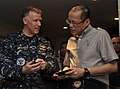 US Navy 110514-N-DR144-854 Capt. Bruce H. Lindsey, commanding officer of the aircraft carrier USS Carl Vinson (CVN 70), presents a command coin to.jpg