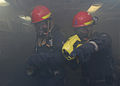 US Navy 110706-N-DU438-201 Damage Controlman Fireman Christopher Beuscher, right, uses a Naval firefighter's thermal imager to see through smoke a.jpg