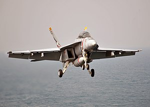 US Navy 120209-N-YB753-084 An F-A-18F Super Hornet assigned to the Bounty Hunters of Strike Fighter Squadron (VFA) 2 approaches the Nimitz-class ai.jpg