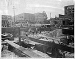 """US Post Office being built in Kinston, NC. Date of this photo is 10 May 1915. View from the back corner of the Post Office looking """"through"""" the building area towards the street that will front the (9617355678).jpg"""