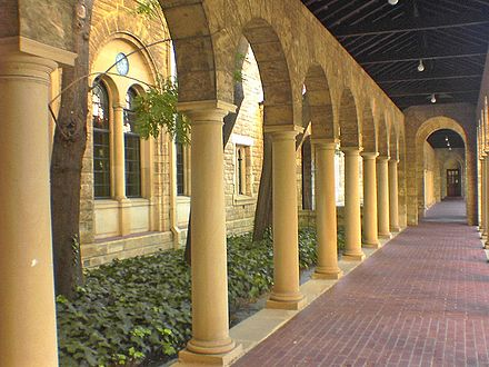 Limestone arches are a prominent feature along the older undercover walkways UWA Arches.jpg