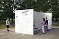 "Unidentified civilians read written comments on the ""Memorial Wall 010916-F-EF792-010.jpg"