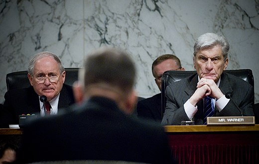 The Senate Armed Services Committee chairman Carl Levin and ranking member John Warner in 2007 hearing opening statements during a confirmation hearing for a position in the Department of Defense. United States Senate Committee on Armed Services, Levin D-MI & Warner R-VA, 7-31-2007.jpg