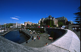 Government Street (Victoria, British Columbia) - View of the Inner Harbour looking north with VRTS double decked buses along Government Street in front of The Empress, 30 April 2005.