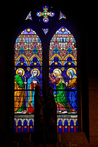 The Visitation, stained glass by Bourdeu, painter and  glass-maker from Toulouse. First lancet; Joseph and Mary; second lancet; Elizabeth and Zechariah.