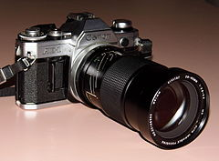 Vintage Canon AE-1 35mm SLR Film Camera With Vivitar 28-85mm Lens, First Microprocessor-Equipped SLR, Manufactured From 1976 - 1984, Both Lens And Camera Body Made In Japan (14966928393).jpg