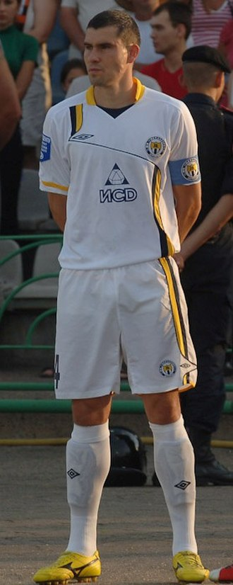 Industrial Union of Donbas - Vyacheslav Checher in the uniform of Metalurh Donetsk (name of the sponsor ИСD on his jersey)