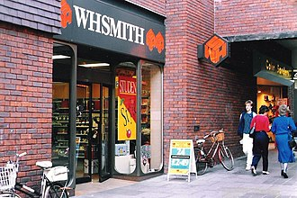 WH Smith bearing the former logo in Huntington, England, in 1986 WH Smith, Huntingdon (geograph 3723249).jpg