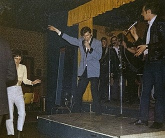 Paul Barrett - Barrett (right) singing with Shakin' Stevens and The Sunsets in 1974