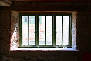 English: A wooden frame glass window in the wa...