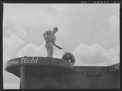 Welder and assistant at the Higgins shipyards 8d39902v.jpg