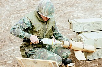 White phosphorus munitions - A USAF Security Police Squadron member packs an 81 mm white phosphorus smoke-screen mortar round during weapons training, 1980