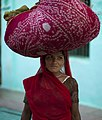 Woman carrying clothes on her head, Rajasthan (6358629711).jpg