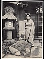 Woman in kimono with Stone Lantern in Japan (1915-05 by Elstner Hilton).jpg