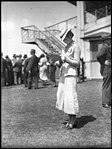 Woman racegoer at Warwick Farm racecourse (3816435113).jpg