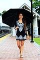 Woman with umbrella (Unsplash).jpg