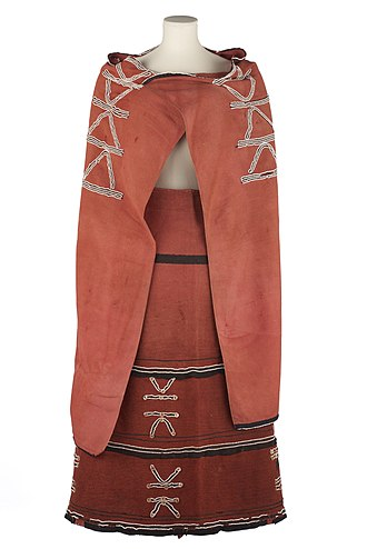 Xhosa people - Xhosa women's outfit, made from cotton blanket fabric coloured with red ochre and decorated with glass beads, mother of pearl buttons and black felt trim