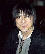 A photograph of a thin, dark-haired Japanese man