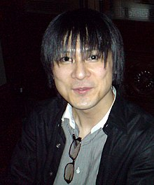 A photograph of a thin, dark-haired Japanese man.