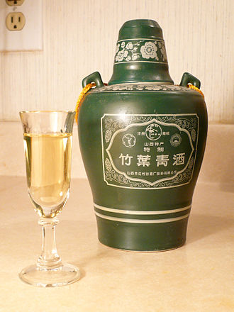 Baijiu - A glass and bottle of Zhuyeqing jiu from Shanxi province