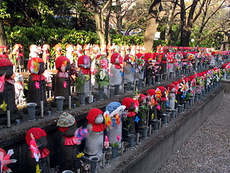 Buddhist ethics - Jizo statues at Zojo-ji temple in Tokyo