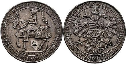 1½ Schautaler von 1565, Zwitterprägung Kaiser Maximilians II., Reiterseite mit FERDINANDUS D:G … und 1541, Adlerseite mit MAXIMILANUS D:G … und 1565 (Maximilian verwendete den Stempel mit dem Reiterbild von Ferdinand, seinem Vater) (Quelle: Wikimedia)