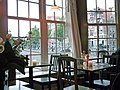 """""""Ease of being"""", view through the window of a café in Amsterdam.jpg"""