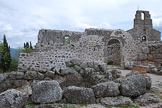 Cichyrus - Part of the remains of Necromanteion, with the church of the monastery Agios Ioannis in the background on the right.