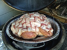uncooked bacon wrapped turkey