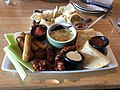 2018-03-25 11 35 28 Classic appetizer combo (Chips with spinach-artichoke dip, mozzarella sticks, honey-bbq buffalo wings and chicken quesadilla) at the Applebee's in Fair Lakes, Fairfax County, Virginia.jpg