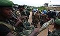 3 décembre 2014. Territoire de Beni, Rd Congo. Des soldats de l'armée congolaise et des casques bleus devant le quartier général de la MONUSCO à Ben (16283788363).jpg