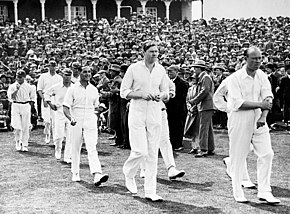 Cricketers walking on to a ground