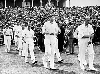 Percy Chapman - Carr (right) and Chapman leading the England team to the third Test against Australia at Headlingley in 1926.