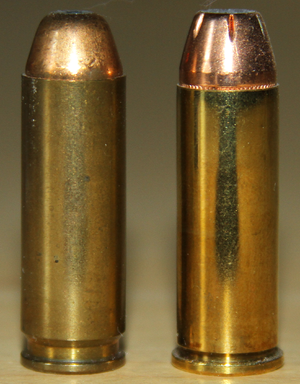 AutoMag (pistol) - A .44 AMP next to a .44 Remington Magnum cartridge.