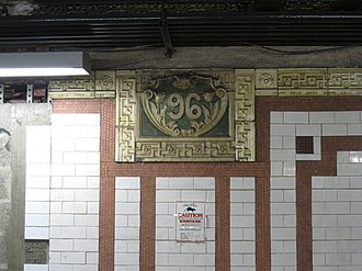 "96th Street (IRT Broadway–Seventh Avenue Line) - Original cartouche on the wall with the number ""96"""