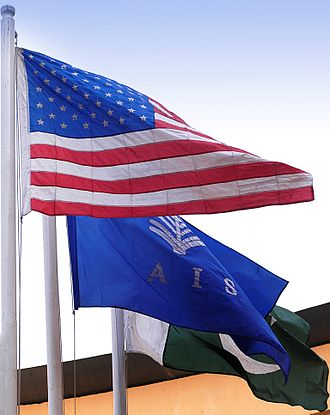 American International School System -  The American, AISS and Pakistan flags greet visitors at the school.