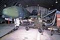 A 30mm ammunition belt is fed into an A-10 Thunderbolt II aircraft with the aid of an ammunition loader - DPLA - 52c4cb2504c98781e0524ef0a9c4a689.jpeg