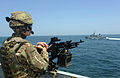 A British sailor mans a machine gun aboard Royal Navy frigate HMS Argyll (F231) while conducting training with the Royal Moroccan Navy offshore patrol vessel Bir Anzaran (P-341) during exercise Saharan Express 130312-N-IY142-291.jpg