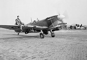 412 Transport Squadron - A Spitfire Mark IXE of No. 412 Squadron taxies out for a sortie at Volkel Air Base in October 1944
