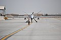 A U.S. Airman with the 451st Air Expeditionary Group motions to an MQ-9 Reaper unmanned aerial vehicle after the aircraft returned to Kandahar Airfield, Afghanistan, March 20, 2014 140320-F-YY948-032.jpg