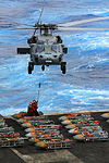 A U.S. Navy MH-60S Sea Hawk helicopter approaches the flight deck of the aircraft carrier USS Enterprise (CVN 65) for another load of ammunition as the ship conducts an ammunition offload in the Atlantic Ocean 121025-N-ZZ999-131.jpg