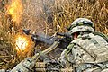 A U.S. Soldier assigned to the 2nd Battalion, 503rd Infantry Regiment, 173rd Infantry Brigade Combat Team fires an M240B machine gun during exercise Combined Resolve 2013 at the 7th Army Joint Multinational 131115-A-BS310-381.jpg