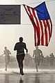 A U.S. Soldier crosses the finish line during a satellite version of the Atlanta Journal-Constitution Peachtree Road Race, 2013, Camp Leatherneck.jpg
