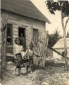 A girl and a boy stand in front of a house, Ontario, 03Q P907P08.tiff