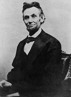 Abraham Lincoln half length seated, April 10, 1865.jpg